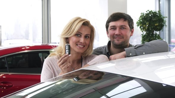 Thumbnail for Beautiful Happy Mature Couple Posing Near Their New Auto Holding Car Keys