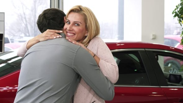 Thumbnail for Gorgeous Happy Mature Woman Receiving Car Keys From Her Loving Husband