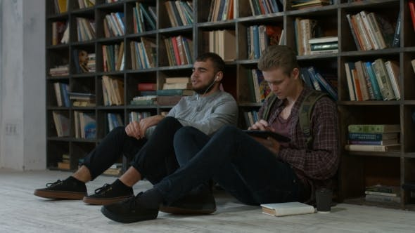 Thumbnail for Hipster Students Studying in Library at University