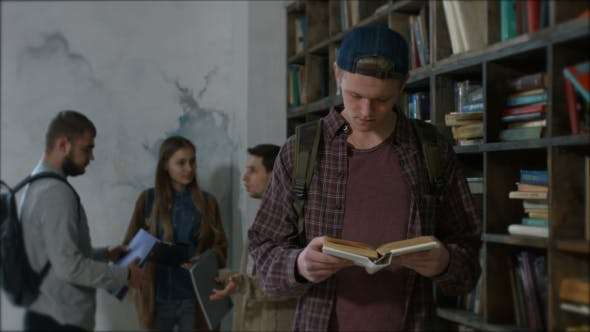 Thumbnail for Handsome High School Student Studying in Library