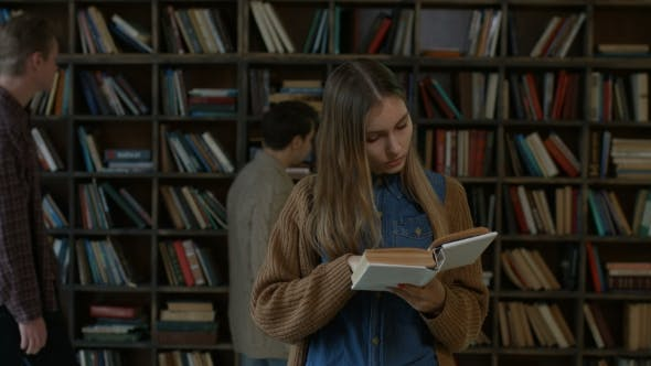 Thumbnail for Gorgeous Female Student Reading a Book in Library