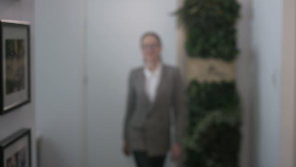 Thumbnail for Young Businesswoman Walking Close To the Camera