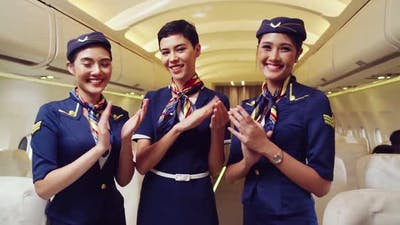 Cabin Crew Clapping Hands in Airplane