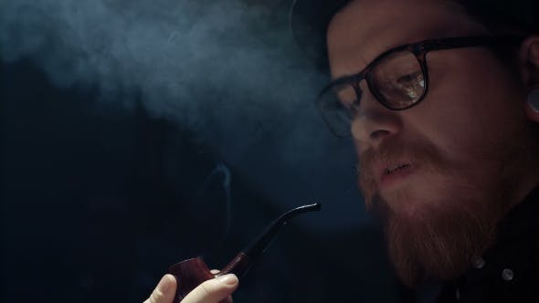 Thumbnail for Portrait of Man Smoking Pipe