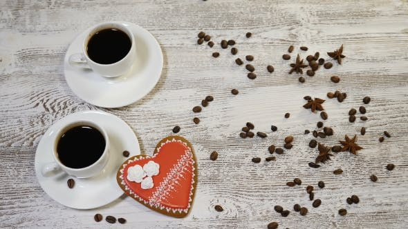 Love Relations Concept Coffee in White Cups Home Made Heart Shaped Ginger Biscuit on Wooden