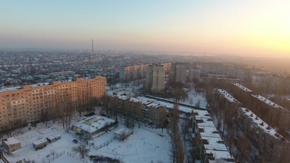 Thumbnail for Aerial Shot of a City Block with Multistoreyed Buildings at Sunset in Winter