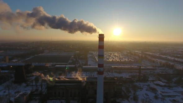 Thumbnail for Aerial Shot of a White and Red Cooling Tower with White Smoke at Sunset in Winter