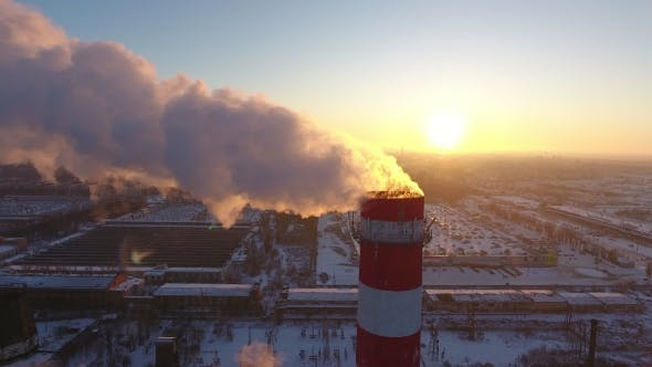 Thumbnail for Aerial  of a Sky-high Cooling Tower with White Smoke at Sunset in Winter