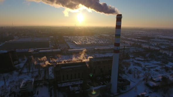 Thumbnail for Aerial Shot of a White and Red Hot Gas Chimney with White Smoke at Sunset in Winter
