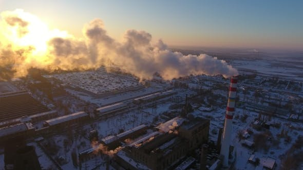 Cover Image for Aerial Shot of a Sky-high Hot Gas Tower with White Smoke at Sunset in Winter