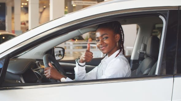 Thumbnail for African Woman Sitting in His New Car.