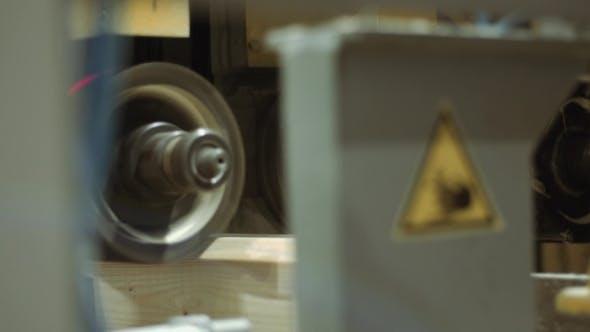 Woodwork Machine Cuts Furrow on Wooden Block at Sawmill Facility