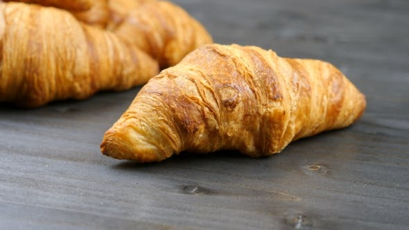 Thumbnail for Delicious Croissants on a Piece of Old Wood