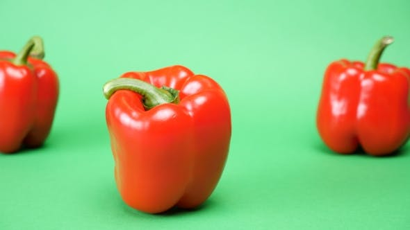 Thumbnail for Five Sweet Red Peppers on Green Background