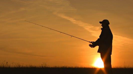Fisherman Throws Fishing Tackles