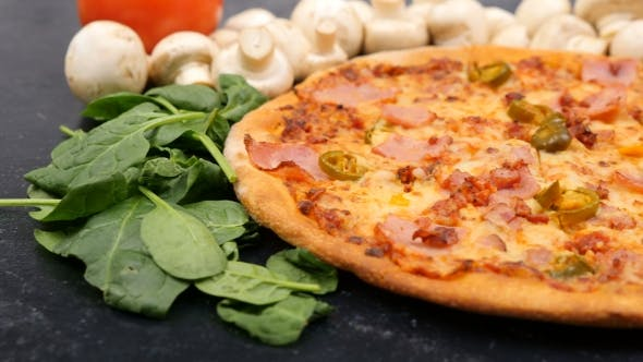 Thumbnail for Leaves of Baby Spinach Falling on Fresh Baked Pizza