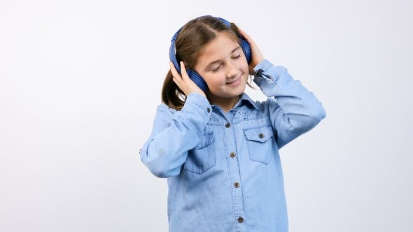 Cover Image for Little Girl with Headphones on Listening To Music