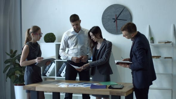 Thumbnail for Business Team Analyzing the Graphs in the Office