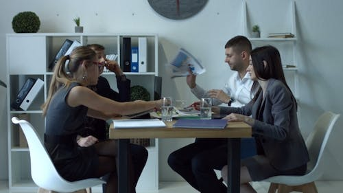 Emotional Businesspeople Arguing at Meeting in Office
