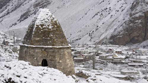 Tomb in the Background of a Mountain Village