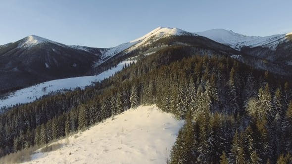 Thumbnail for Beautiful Winter Aerial Flight Over Mountain Chain Landscape Adventure Hiking Trekking Ski Vacation