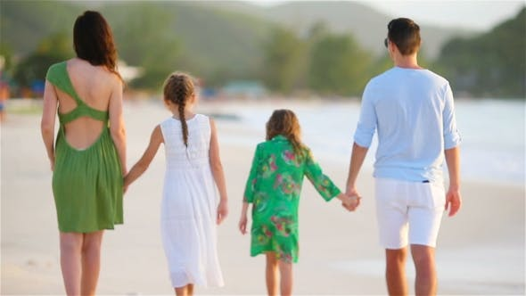 Thumbnail for Family of Four with Two Kids Walking on the Beach on Caribbean Vacation