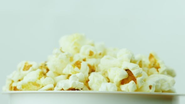 Thumbnail for A Glass of Popcorn on a White Background. Slowly Rotates