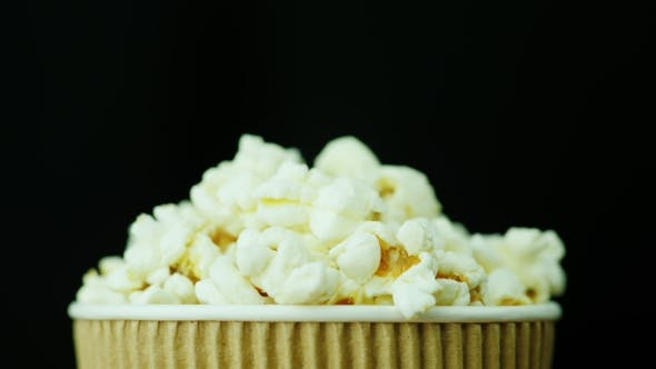 Cover Image for A Paper Glass of Popcorn, Slowly and Smoothly Rotates on a Black Background