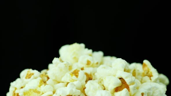 Thumbnail for A Bunch of Popcorn on a Black Background