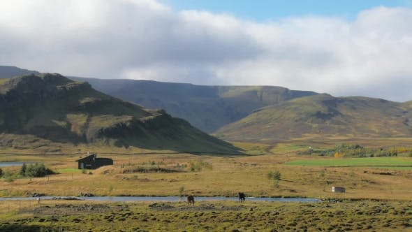 Thumbnail for of Countryside Icelandic Landscape, Clouds Are Moving Over Mountains, Two Horses