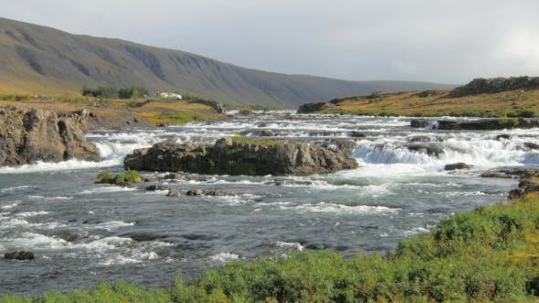 Thumbnail for Small River Flowing From the Mountains in Icelandic Calm Landscape with Mountains