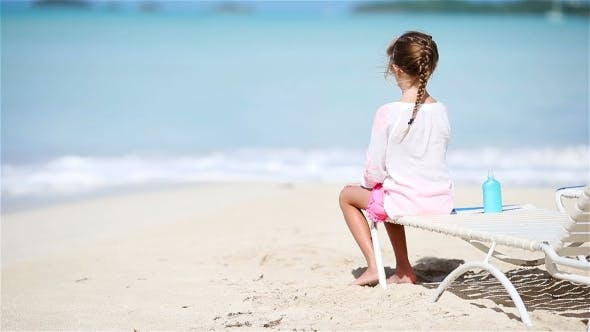 Thumbnail for Little Girl Enjoying Tropical Beach Vacation on Sunbed Looking at the Sea