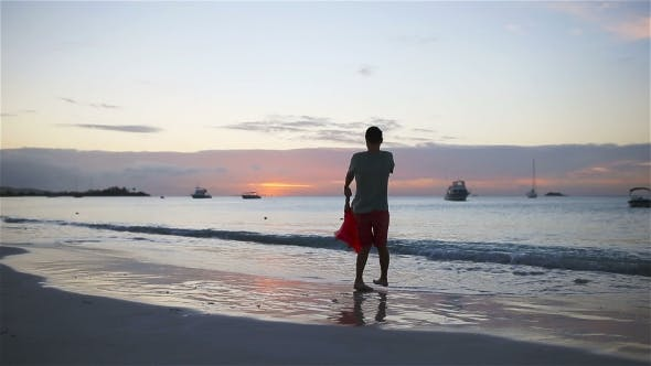Thumbnail for Little Girl and Happy Dad Having Fun at Sunset during Beach Vacation