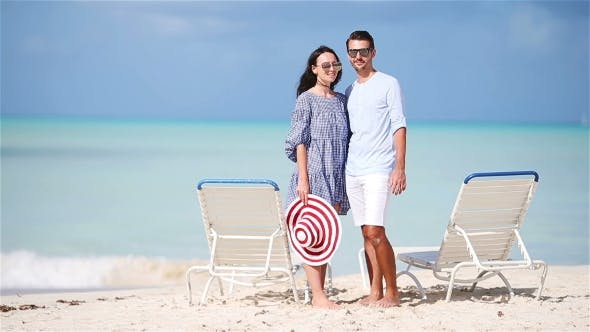 Young Couple on White Beach During Summer Vacation Enjoy Their Honeymoon