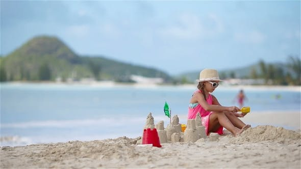 Thumbnail for Adorable Little Girl Playing with Toys on Beach Vacation