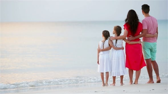 Thumbnail for Young Family of Four on Beach Vacation on the Sunset