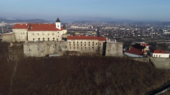 Cover Image for Beautiful Panoramic Aerial View To Palanok Castle at Sunset and the City of Mukachevo