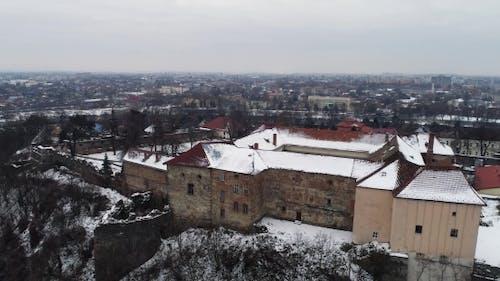Aerial Beatiful Grimly View on Uzhhorod Castle in Winter.