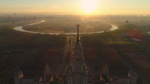Moscow State University in the Sunny Morning and City in Sunrise Fog