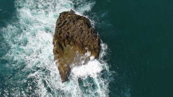 Aerial Drone Bird's Eye View Video on Sea Waves and Rocks, Turquoise Water. Tropical Paradise