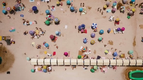 Thumbnail for Aerial View of a Crowded Beach in a Sunny Hot DayYellow Sand and Umbrellas