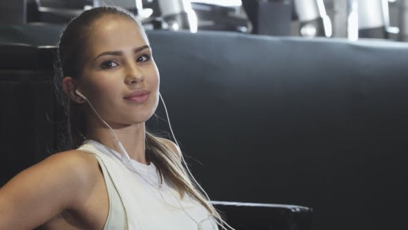 Thumbnail for Young Attractive Sportswoman Listening To Music Smiling To the Camera
