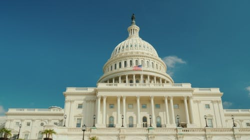 The Majestic Famous Capitol Building in Washington, DC. Against the Background of the Blue Sky