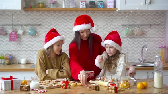 Happy Family Mother and Daughters Bake Cookies for Christmas