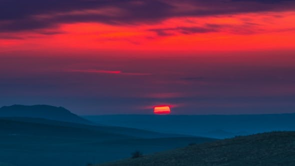 Cover Image for Red Sunset in the Mountains Landscape with Cloudy Sky