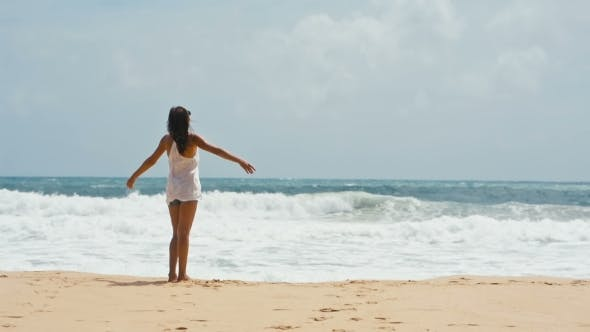 Thumbnail for Young Woman Lifts Hands Up on the Sea Background