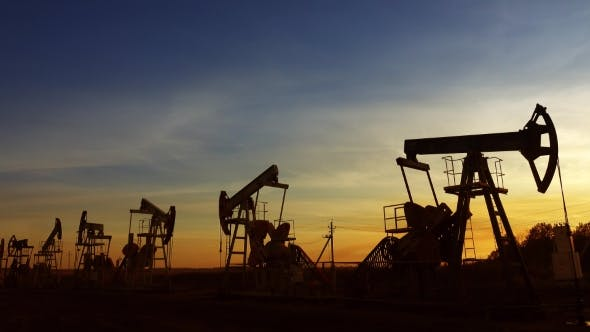 Thumbnail for Many Working Oil Pumps Silhouette Against Sunset