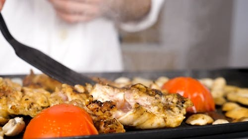 Smoking and Steaming Pieces of Grilled Chicken