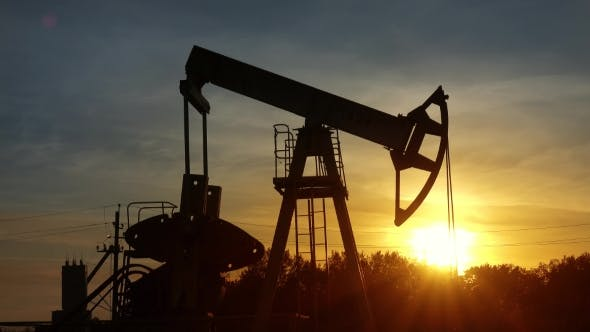 Thumbnail for Working Oil Pump Silhouette Against Sunset