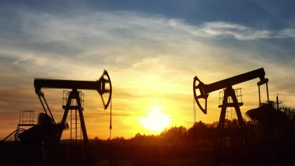 Thumbnail for Working Oil Pumps Against Sunset